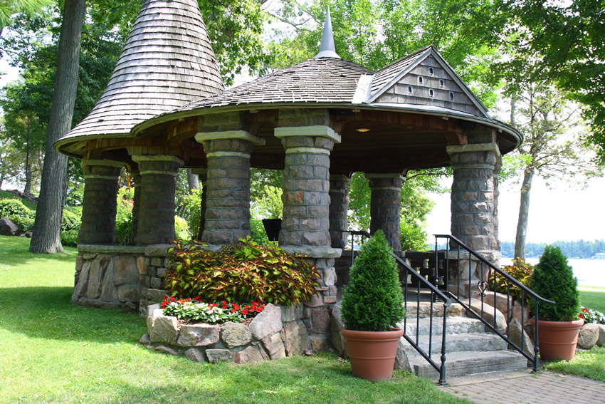 Lakeside rock gazebo with wood shingles