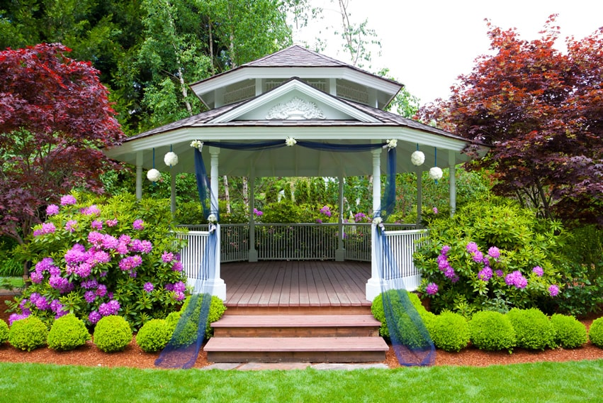 Large elegant white gazebo with railing