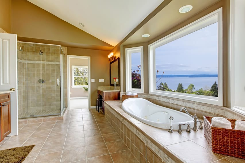 Spacious bathroom with amazing views, using budget-friendly materials