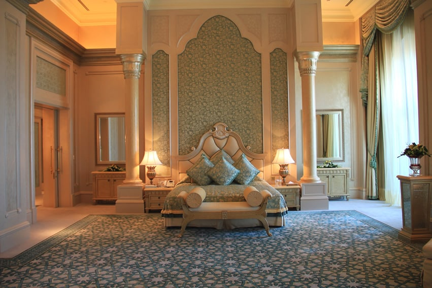 Large master bedroom with majestic style and pillars