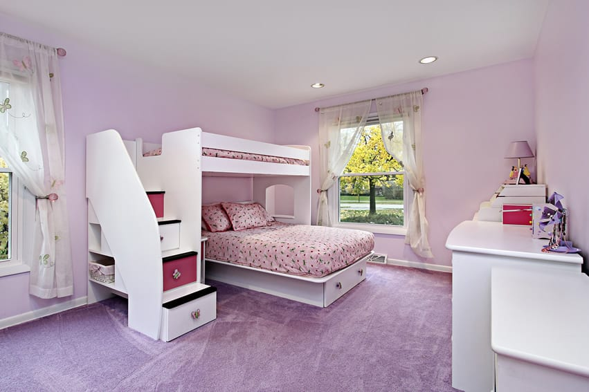 Purple themed girl's room with bunk bed and secret storage area