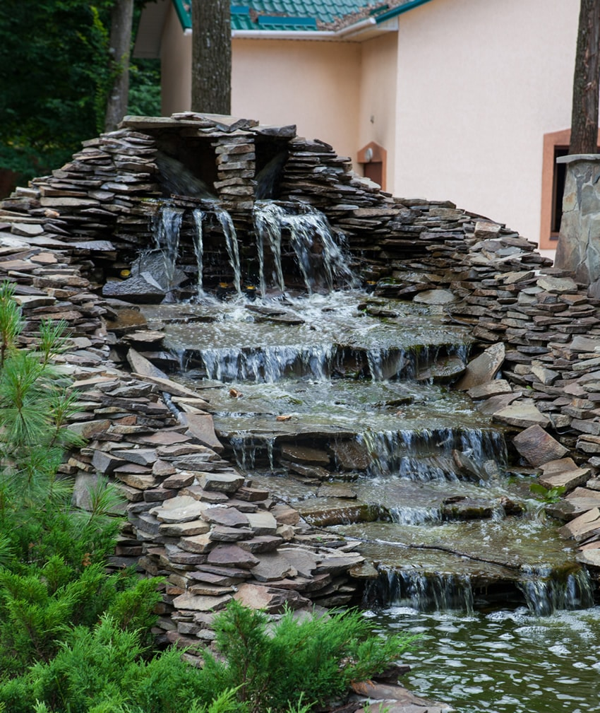 Large slate waterfall in garden