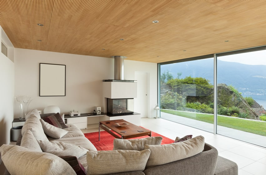 Large windowed living room with lake view