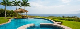 light-blue-pool-ocean-view-thatched-cabana