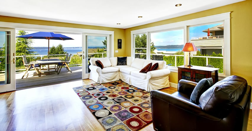 Living room with bay views and large wraparound deck