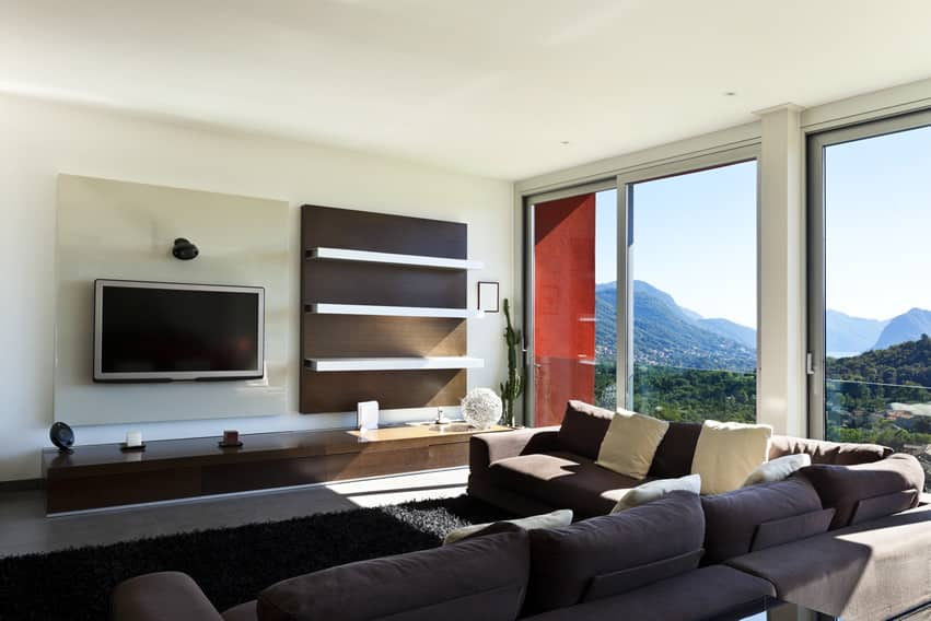 Living room interior of a modern design home with mountain window view