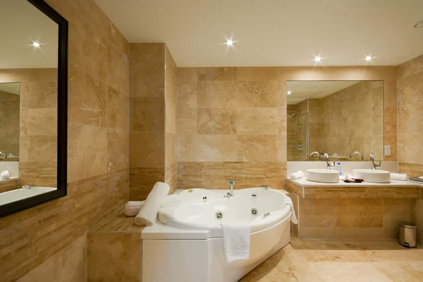 luxury bathroom with walls and the floors in natural travertine stone tiles