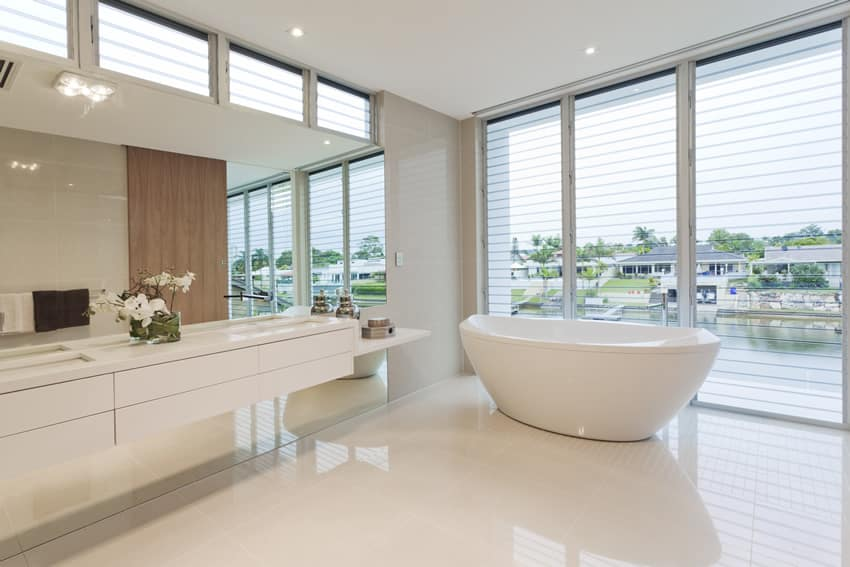 Luxury bathroom with water view and white Italian glazed porcelain tiles