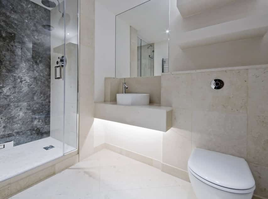 Modern bathroom design is spacious with natural limestone tiles