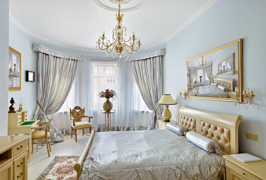 Luxury master bedroom in silver, gold and blue