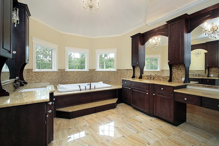 Spacious bathroom that has a beautiful contrast of dark and light colors