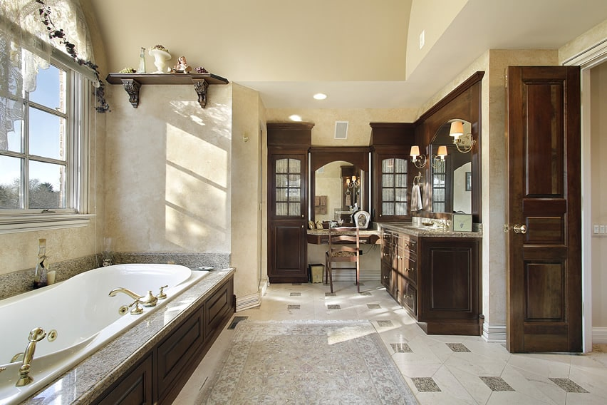 Cozy bathroom design with classical design elements using marble porcelain tiles with smaller pieces of granite tiles