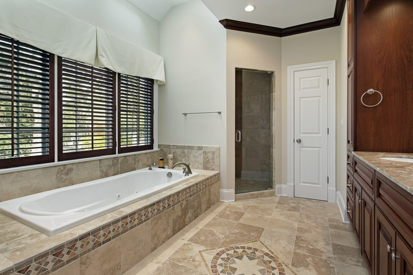 Natural stone tile bathroom with accent tile design