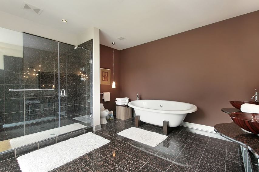 Bathroom uses 30x30 polished porcelain tiles in a natural stone finish