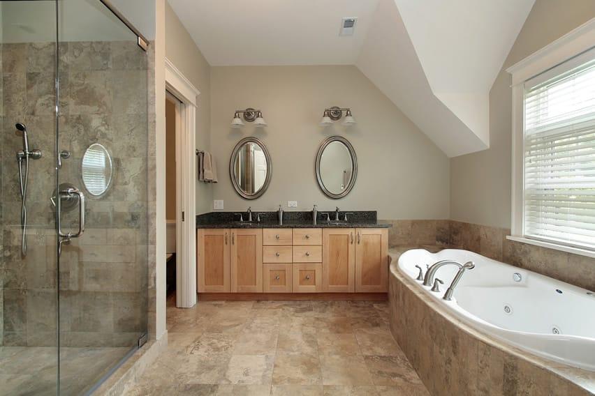 Simple bathroom design uses natural stone ceramic tiles in beige tones