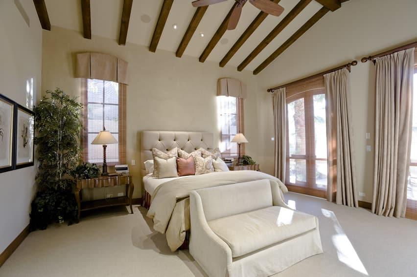 Master bedroom exposed wood beams