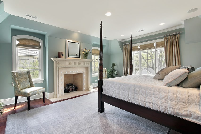 Master bedroom in new home with large post bed