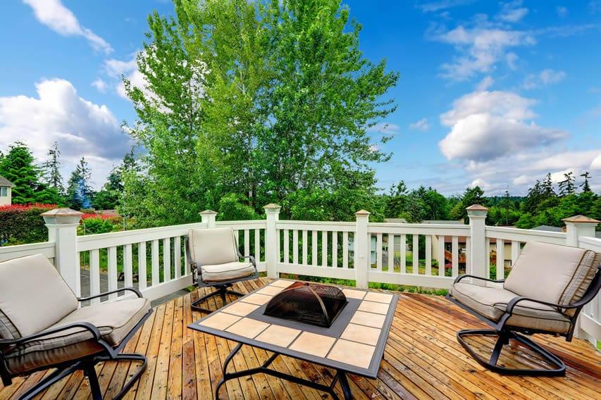 Metal tile fire pit on backyard deck