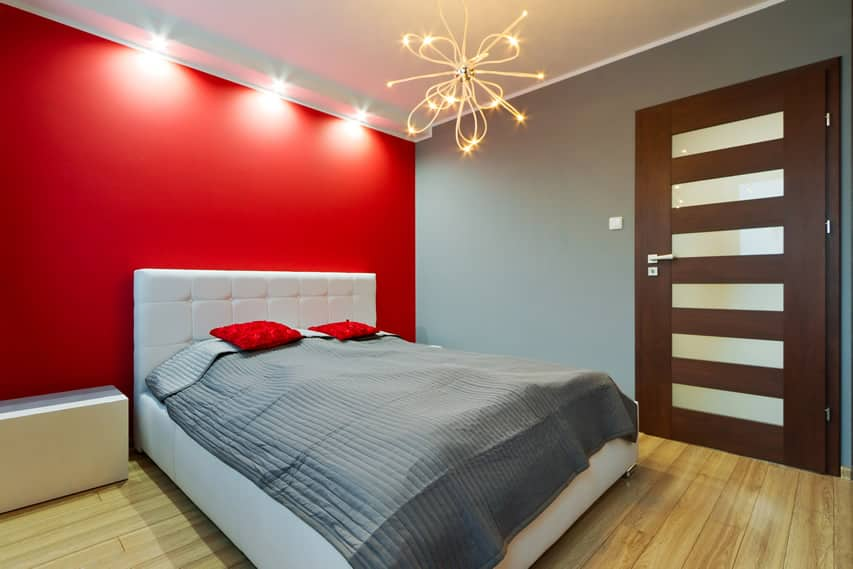 Modern bedroom red wall white headboard