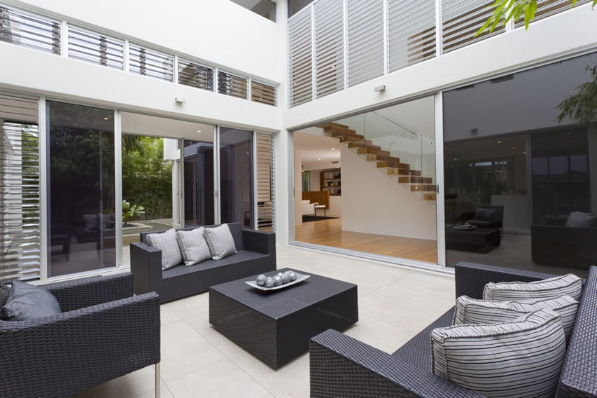 Modern outdoor living room patio area with black and grey theme