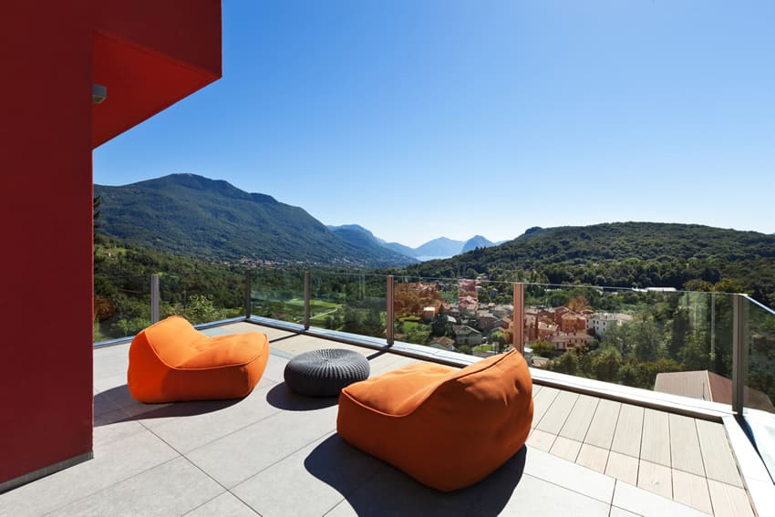 Balcony patio with modern furniture and mountain views
