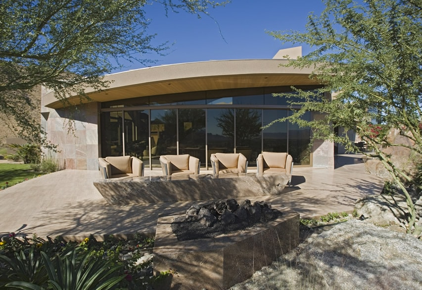 Modern open patio design with stone fire pit