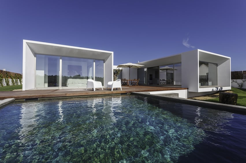 Modern house with swimming pool and wood deck