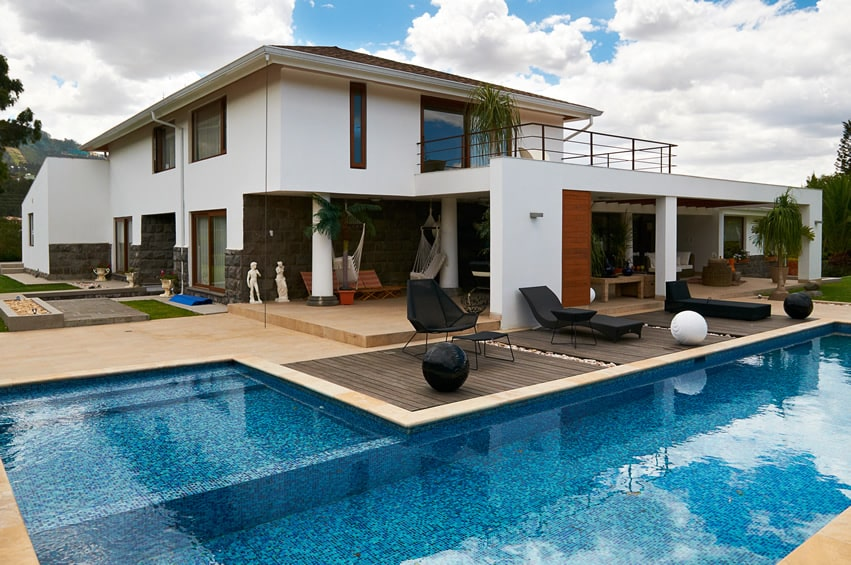 Modern style home with L shaped pool