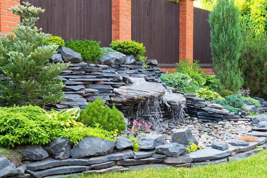 Natural backyard landscaping with water feature