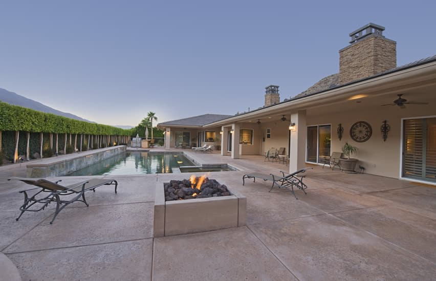 Swimming pool patio with outdoor fire pit