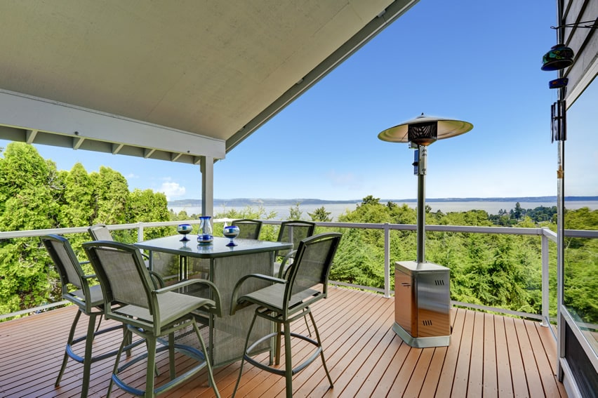 Balcony patio with ocean view and outdoor heater