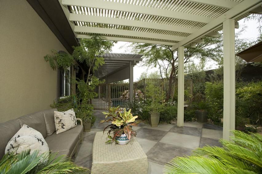 Garden patio area with white pergola and outdoor furniture