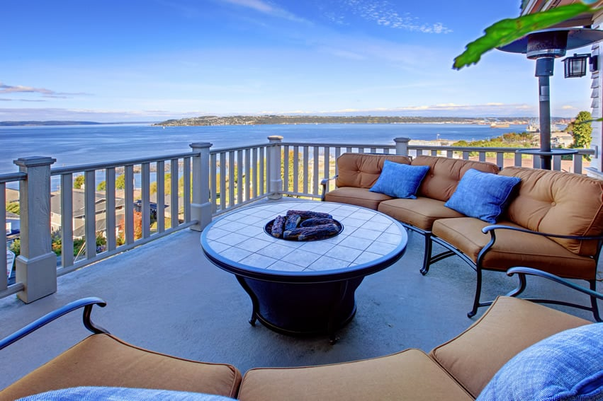 Country-inspired balcony patio with amazing view of the ocean and fire pit