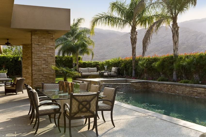 Lagoon pool patio area with outdoor dining area and different types of seating