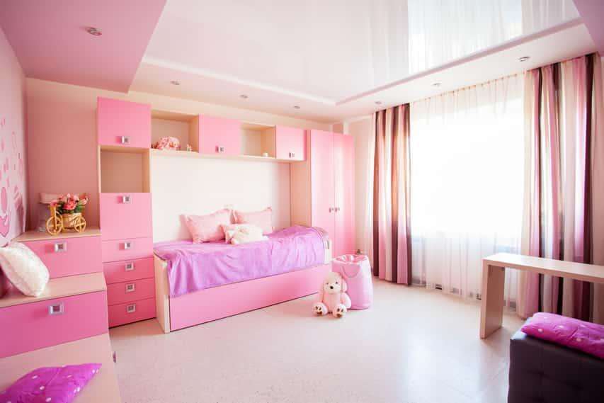 Pink and white girl's room with tons of storage