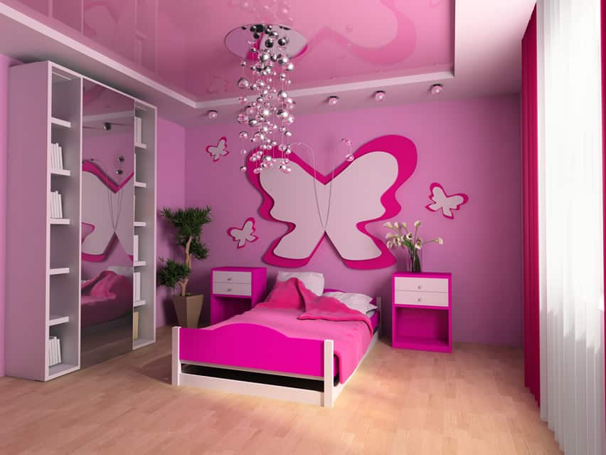 Butterfly themed girl's bedroom with hanging decor and pink design