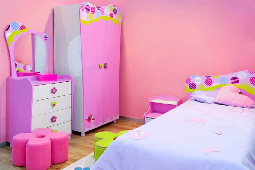 Cheerful girl's bedroom with flowers and polka dots