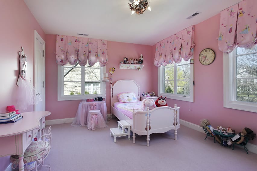 Soft pink girl's bedroom with pink patterned valances