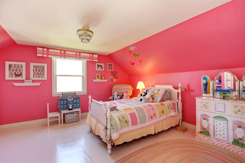 Pink girl's bedroom with white vaulted ceiling and small tiered chandelier