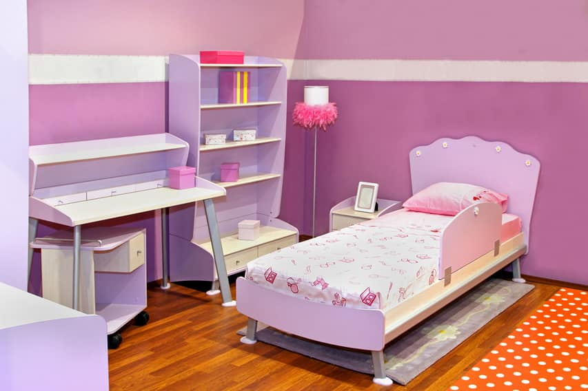 Girl's bedroom with purple theme and furniture