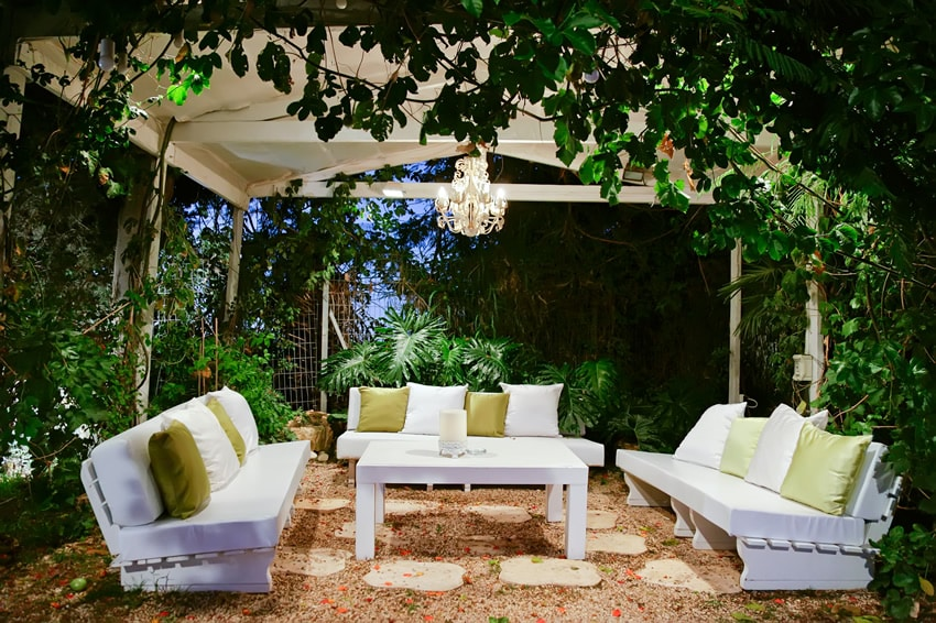 Outdoor patio with a very natural feel surrounded by plants