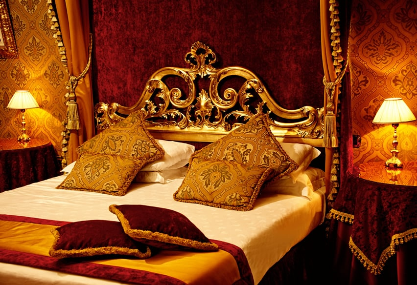 Royal bedroom with gold decor