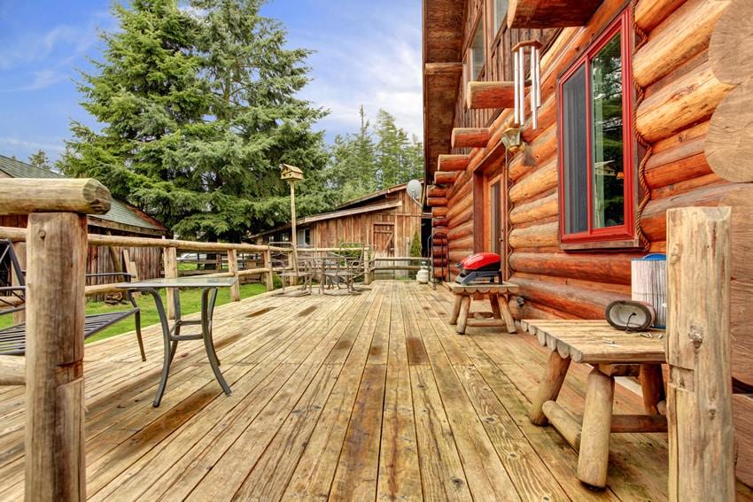 Rustic deck at log cabin backyard