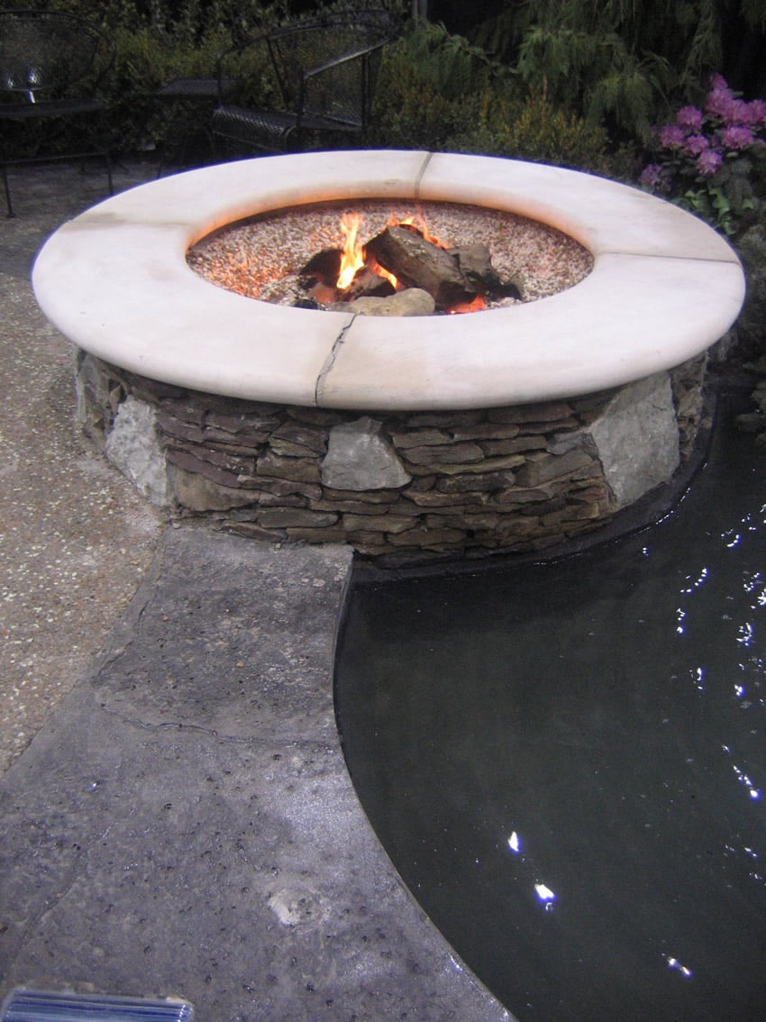 Slate fire pit overlooking pool