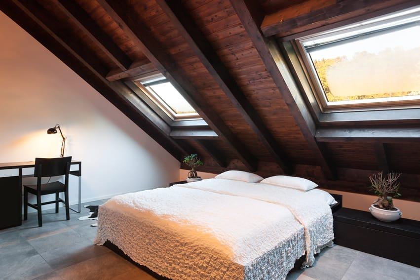 Stylish attic bedroom white bed
