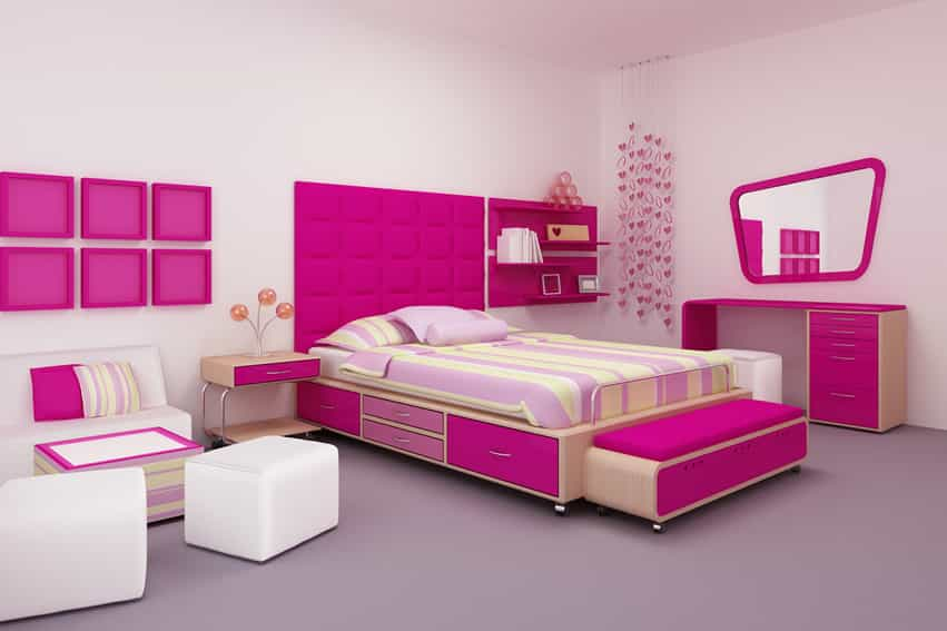 Bright pink girl's room with striped bedspread and pink decor