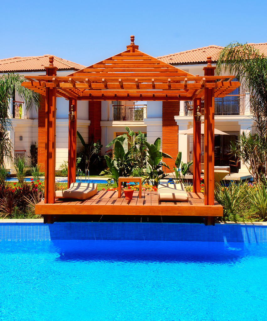 Swimming pool gazebo with lounge chairs