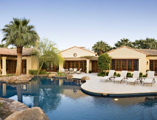 Swimming pool large rocks beautiful house designing idea for Beautiful house designs with swimming pool
