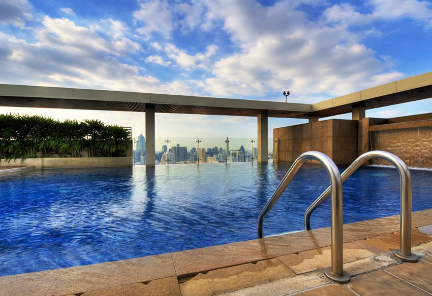 Swimming pool on top of highrise building with city view