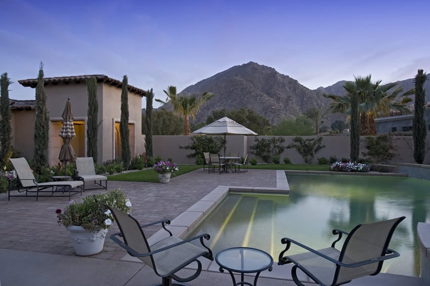 Swimming pool overlooking mountains and palm trees